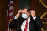 "Chairman Sen. John Brasso (R-WY) puts on a mask at a hearing titled ""Oversight of the Environmental Protection Agency"" before the US Senate Environment and Public Works Committee in the Dirksen Senate Office Building on May 20, 2020 in Washington, DC.  EPA Administrator Andrew Wheeler will be asked about the rollback of regulations by the Environment Protection Agency since the pandemic started in March.  <br /> Credit: Kevin Dietsch / Pool via CNP/AdMedia"