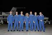 Cape Canaveral, FL - June 10, 2009 -- The STS-127 crew poses for a group portrait following their arrival at the Shuttle Landing Facility at NASA's Kennedy Space Center in Florida. From left are Mission Specialists Tim Kopra, Tom Marshburn, Christopher Cassidy, and Julie Payette of the Canadian Space Agency; Commander Mark Polansky; Pilot Doug Hurley; and Mission Specialist Dave Wolf. .Mandatory Credit: Kim Shiflett  - NASA via CNP