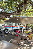 USA, Hawaii, The Big Island, mountain bikers take a break and have lunch at da fish house lunch wagon in Kawaihae