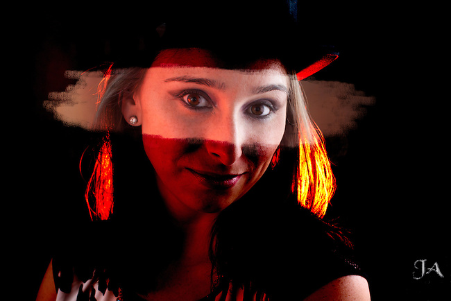 Portrait of Pretty woman with Top hat, riveting eye contact and Hollywood lighting effect.