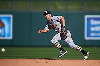 Glendale Desert Dogs shortstop Adam Frazier (12) makes a play on a ground ball during an Arizona Fall League game against the Surprise Saguaros on October 23, 2015 at Salt River Fields at Talking Stick in Scottsdale, Arizona.  Glendale defeated Surprise 9-6.  (Mike Janes/Four Seam Images)