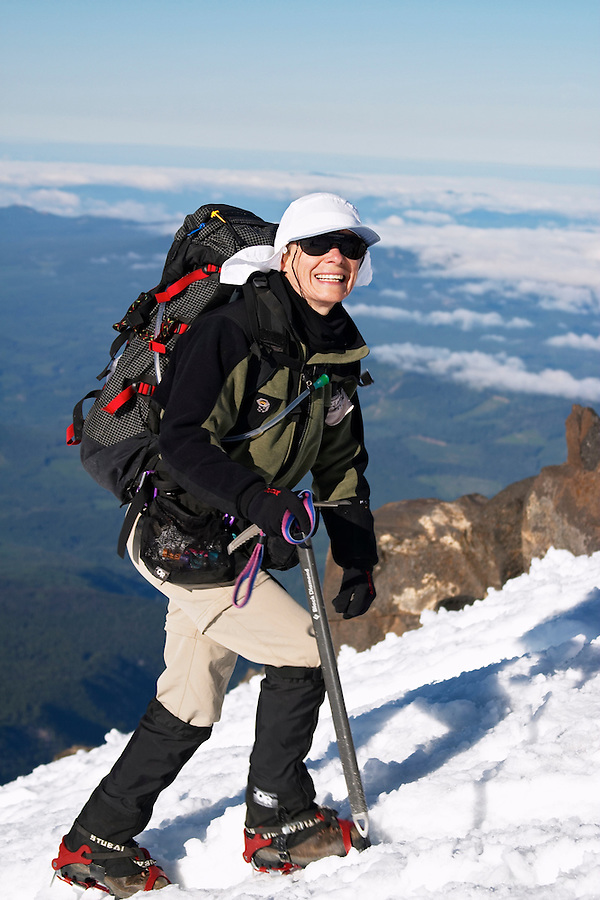 Woman climbing up snow on Mount Adams, Yakima County, Cascade  Mountains, Washington, USA