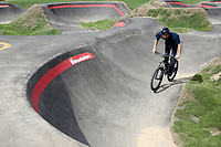 NWA Democrat-Gazette/DAVID GOTTSCHALK Daiki Shimogaki, of Japan, takes a practice run Tuesday, October 9, 2018, the pump track at the Runway Bicycle Skills Park at the Jones Center in Springdale. The park will host the Pump Track (bicycling) World Championships sponsored by Red Bull on Saturday, October 13. A pump track is designed so that bikers pump and push on hills and turns to build speed using their upper body and hips instead of pedaling.
