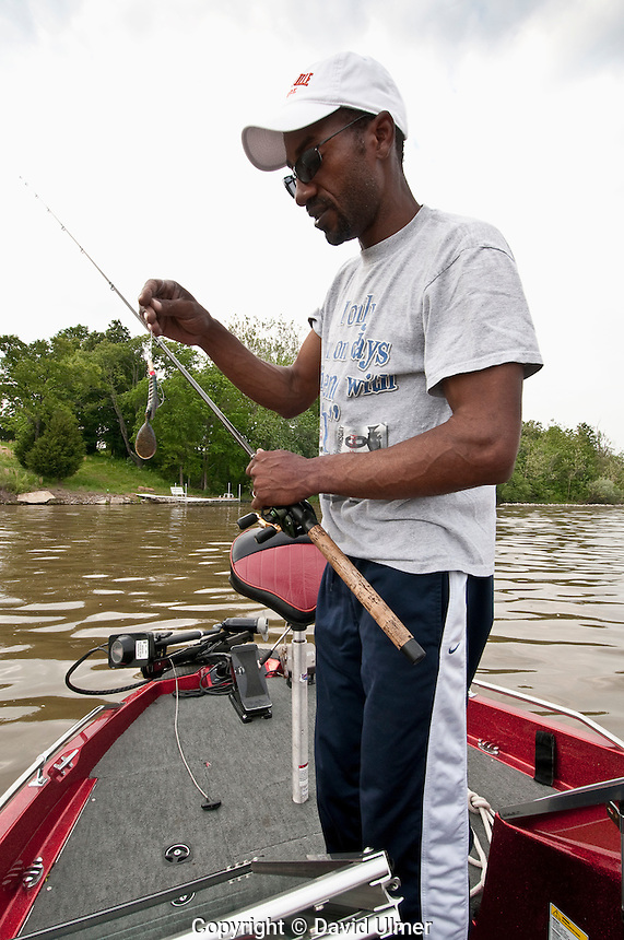 African American man competing in bass fishing tournament