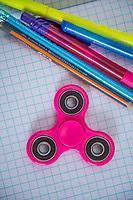 A fidget spinner toy in a school setting