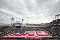SAN FRANCISCO, CA - December 29, 2012: The American Flag during the National Anthem before the Navy Midshipmen vs the Arizona State Sun Devils in the 2012 Kraft Fight Hunger Bowl at AT&T Park in San Francisco, California. Final score Navy 28, Arizona State 62.