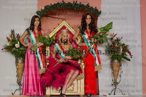 Marianna Bertok (C) winner poses with Evelin Beres (L) and Nora Keseru (R) runner ups of the Miss Hungary beauty contest held in Budapest, Hungary on December 29, 2011. ATTILA VOLGYI