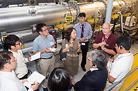 MSU Institute for Clean Energy Technology Director Charles Waggoner (right) explains ICET&rsquo;s filter testing capabilities to visitors from Japan.<br />  (photo by Beth Wynn / &copy; Mississippi State University)