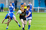 Austin Stacks Shane O'Callaghan gets away from Kerins O'Rahilly's players Ross O'Callaghan No 3 and Rory Molloy when the sides met at Starnd Road last Saturday evening in the Div1 league.