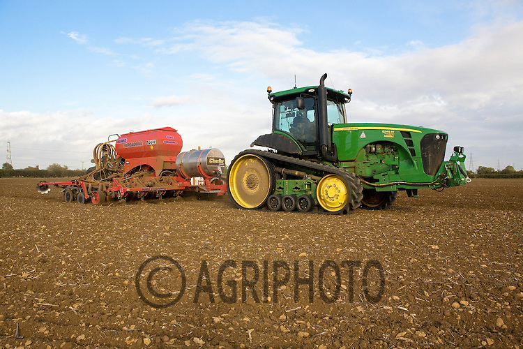 John Deere Rubber track with a Moore Sumo Versadrill drilling Winter Wheat on R Naylor & Son Wood Farm,Uffington,Stamford,Lincolnshire.Picture Tim Scrivener date taken 22nd September  2011 .mobile 07850 303986 e-mail tim@agriphoto.com.....covering Agriculture in The United Kingdom.....