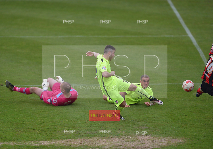 07/05/2016 Sky Bet League Two Morecambe v York City<br /> Kenneth McEvoy shot blocked by Lee Molyneux