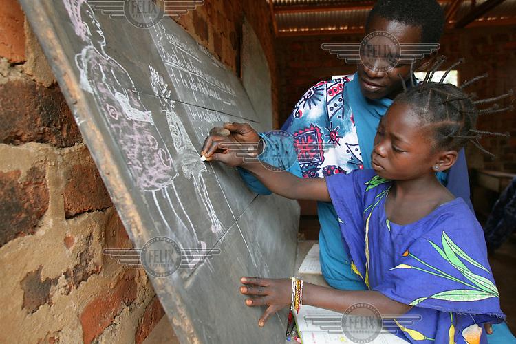 Teacher and school girl at community school.