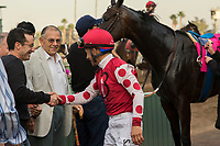 ARCADIA, CA  JANUARY 07:Mike Smith receives congratulations in the winners circle after piloting Midnight Bisou to her break her maiden by winning the Santa Ynez Stakes (Grade ll) on January 7, 2018, at Santa Anita Park in Arcadia, CA. (Photo by Casey Phillips/ Eclipse Sportswire/ Getty Images)