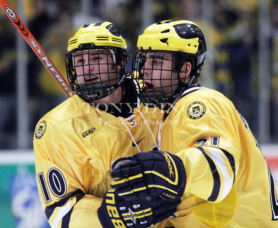 11 March 2006: Michigan forwards Travis Turnbull (10) and Jason Bailey react to an unrewarded goal during the second period of Ferris State's CCHA quarterfinal-round conference championships game vs No. 14 Michigan, at Yost Ice Arena in Ann Arbor, MI.  Michigan advances to the CCHA Semi-finals winning 3-2.