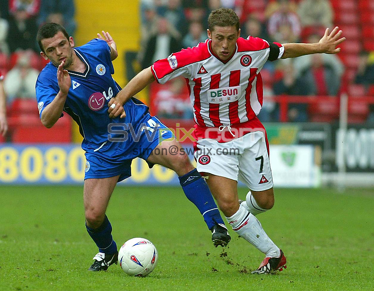 Pix, Shaun Flannery/SWpix. Nationwide League Division One..Sheffield United v Leicester City, 21/4/2003..COPYRIGHT PICTURE>>SIMON WILKINSON>>01943 - 436649>>..United's Michael Brown beats Leicester's Matt Heath.
