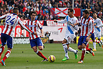 Atletico de Madrid´s Tiago Cardoso and Koke and Deportivo de la Coruña´s Rodriguez (C) during 2014-15 La Liga match between Atletico de Madrid and Deportivo de la Coruña at Vicente Calderon stadium in Madrid, Spain. November 30, 2014. (ALTERPHOTOS/Victor Blanco)