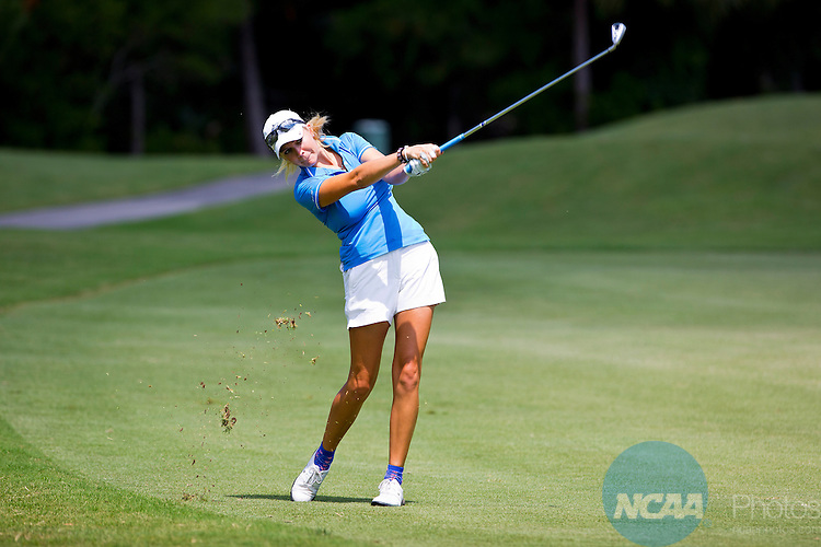 18 MAY 2013: Abbey Gittings of Nova Southern hits an iron on the fairway during the Division II Women's Golf Championship held at the LPGA International Golf Course in Daytona Beach, FL. Gittings placed 8th overall in the tournament while her team took second.  Lynn University shot a +17 to win the national title by 3 strokes.  Matt Marriott/NCAA Photos
