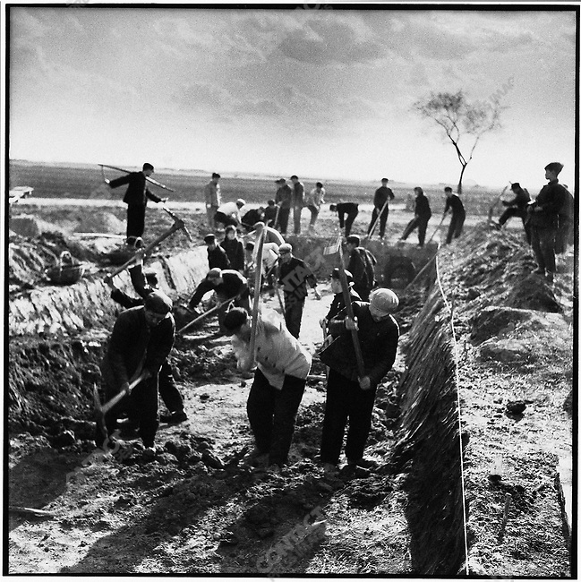 Organized in production brigades, peasants are assigned backbreaking farmwork such as constructing pigsties and tilling fields. Liaodian commune, Acheng county, 14 May 1965