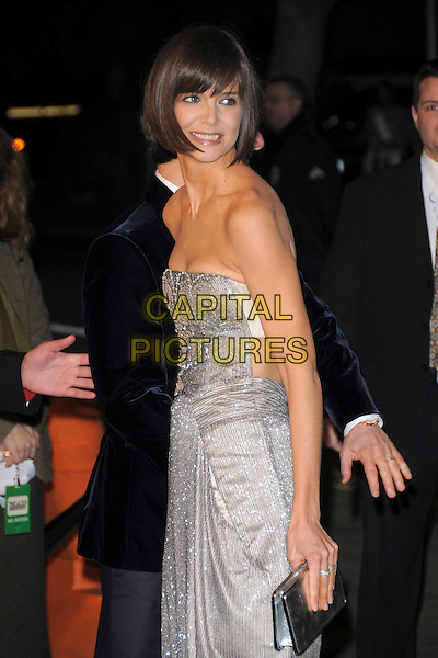"KATIE HOLMES .Overature Pictures' L.A. Premiere of ""Mad Money"" held at The Mann Village Theatre in Westwood, California, USA..January 9th, 2008.half length strapless silver dress jewel encrusted clutch bag purse beads beaded.CAP/DVS.©Debbie VanStory/Capital Pictures"