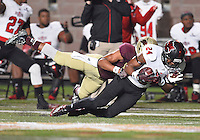 Arkansas State wide receiver Blake Mack (24) is brought down by Texas State defender during NCAA Football game, Thursday, November 20, 2014 in San Marcos, Tex. Texas State leads Arkansas State 28-14 at the halftime. (Mo Khursheed/TFV Media via AP Images)