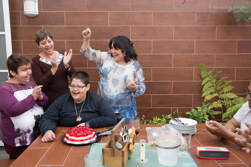 Lupita embraces her boyfriend Jorge during a family lunch to celebrate his 34th birthday at her home in Mexico City, Mexico on March 31, 2017. Maria Guadalupe Pilar Saucedo Granda, 43, and Jorge Antonio Moreno Gaytán, 34, both diagnosed with Prader-Willi syndrome, have been in a relationship for 11 years. They met at an annual meeting organized by the Mexican Prader-Willi Association Fundación María José in Pachuca, Mexico. They call each other daily but only see each other three to four times a year. They dream about getting married one day. Prader-Willi Syndrome (PWS) is a rare genetic disorder caused by an abnormality in chromosome 15. Innewbornssymptoms includeweak muscle tone (hypotonia), poor appetite and slow development. In childhood the person experiences a sensation of constant hunger no matter how much he/she eats which often leads toobesityandType 2 diabetes. There may also be mild to moderateintellectual impairmentand behavioral problems. Physical characteristics include a narrow forehead, small hands and feet, short in stature, and light skin color. Prader-Willi syndrome has no known cure. However, with early diagnosis and treatment such as growth hormone therapy, the condition may improve. Strict food supervision is typically required. PWSaffects an estimated 1 in 10,000 to 30,000 people worldwide. (Photo by Bénédicte Desrus)