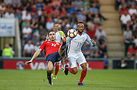 Ole Selnaes of Norway & Nathan Redmond (Southampton) of England battle during the International EURO U21 QUALIFYING - GROUP 9 match between England U21 and Norway U21 at the Weston Homes Community Stadium, Colchester, England on 6 September 2016. Photo by Andy Rowland / PRiME Media Images.