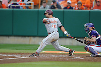 Florida State Seminoles second baseman John Sansone #12 swings at a pitch during a game against the Clemson Tigers at Doug Kingsmore Stadium on March 22, 2014 in Clemson, South Carolina. The Seminoles defeated the Tigers 4-3. (Tony Farlow/Four Seam Images)