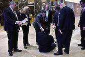 Security team members surround a man as he sits down for the second time in the lobby of the Trump Tower in New York, NY, on January 4, 2017.<br /> Credit: Anthony Behar / Pool via CNP