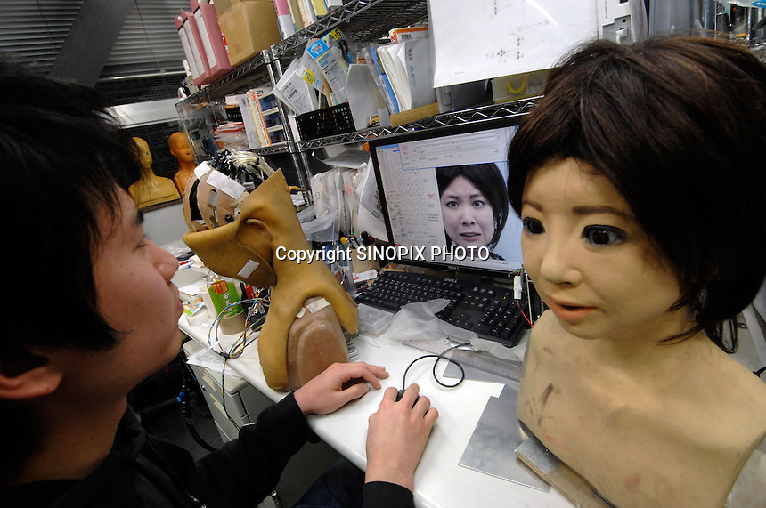 """Developers an researchers at the Kobayashi Lab at the Department of Mechanical Engineering manipulates the facial """"muscle"""" and expressions on a robotic """"saya"""". The Saya is a robotis face that is able to change facial expressions and talk. ..photo by Richard Jones"""