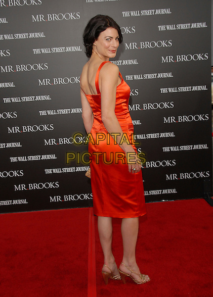 "TRACI DINWIDDIE.attends The L.A. Premiere of ""Mr. Brooks"" held at .The Grauman's Chinese Theater in Hollywood, California,.USA, May 22nd 2007..full length orange tracie dinwiddy looking back over shoulder.CAP/DVS.©Debbie VanStory/Capital Pictures"