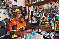Carolina, Hairdresser, Dar es Salaam, Tanzania 2014<br /> Carolina Ndaki started Celina Hair Salon with help from a $150 microfinance loan and named the salon after her daughter. After nine years of regular customers, she was able get a $900 loan and grow her business. These small loans help women to work, become entrepreneurs, and elevate themselves from poverty to help support their families.