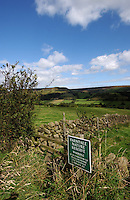 Sign for Farndale nature reserve and the green countryside of the Yorkshire moors, Farndale moor, north Yorkshire, England. september 07.