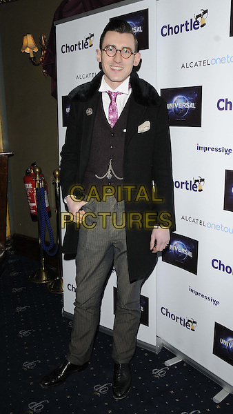 Ben Shires.attended the Chortle Comedy Awards 2013, Cafe de Paris, London, England..March 25th, 2013.full length black coat jacket brown suit pinstripe waistcoat pink tie glasses grey gray trousers .CAP/CAN.©Can Nguyen/Capital Pictures.