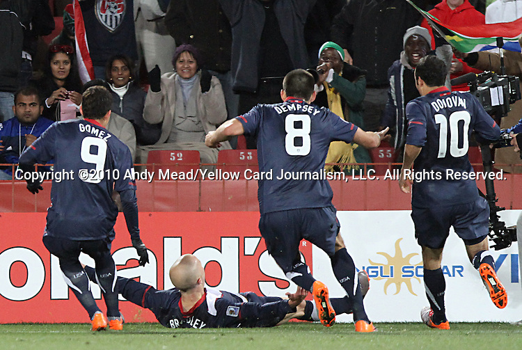 18 JUN 2010:  Michael Bradley (USA)(on ground), Herculez Gomez (USA)(9), Clint Dempsey (USA)(8), and Landon Donovan (USA)(10) celebrate Bradley's game tying goal.  The Slovenia National Team tied the United States National Team 2-2 at Ellis Park Stadium in Johannesburg, South Africa in a 2010 FIFA World Cup Group C match.
