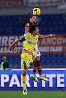 Calcio, Serie A: Roma vs ChievoVerona. Roma, stadio Olimpico, 31 ottobre 2013.<br /> AS Roma midfielder Kevin Strootman, of the Netherlands, top, and ChievoVerona midfielder Simone Bentivoglio jump for the ball during the Italian Serie A football match between AS Roma and ChievoVerona at Rome's Olympic stadium, 31 October 2013.<br /> UPDATE IMAGES PRESS/Isabella Bonotto