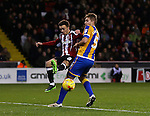 Stefan Scougall of Sheffield Utd and Olly Lancashire of Shrewsbury during the English League One match at the Bramall Lane Stadium, Sheffield. Picture date: November 19th, 2016. Pic Simon Bellis/Sportimage