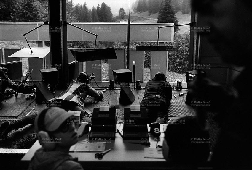 "Switzerland. Canton Glarus. Elm. Cantonal shooting fair. A group of shooters (men and women) aim their rifles and automatic or semi-automatic assault rifles SG 550 on targets distant 300 meters. The SG 550 is an assault rifle manufactured by Swiss Arms AG (formerly Schweizerische Industrie Gesellschaft) of Neuhausen, Switzerland. ""SG"" is an abbreviation for Sturmgewehr, or ""assault rifle"". The rifle is based on the earlier 5.56mm SG 540 and is also known as the Fass 90 or Stgw 90. An assault rifle is a selective-fire rifle that uses an intermediate cartridge and a detachable magazine.19.08.2017 © 2017 Didier Ruef"