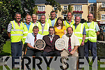 BEST KEPT TOWN: Niall O'Donoghue and Members of Killarney UDC celebrate winning the Tidy Towns Best Kept Town award in Killarney on Tuesday.