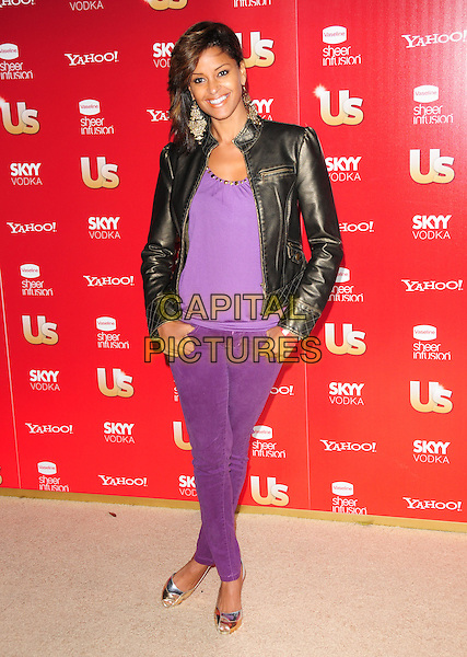 CLAUDIA JORDAN.US Weekly's Hot Hollywood Party 2009 held at Voyeur, West Hollywood, California, USA. .November 18th, 2009.full length black leather jacket purple top jeans denim .CAP/RKE/DVS.©DVS/RockinExposures/Capital Pictures.