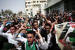 Palestinians react after the coffin of Italian activist Vittorio Arrigoni was removed from al-Shifa hospital in Gaza City April 18, 2011. Friends of the Italian activist Arrigoni arrived in Gaza to escort his body to Italy via Egypt. Hamas found his body on Friday after he was killed by al Qaeda sympathisers in the Gaza Strip. Photo by Mohammed Othman