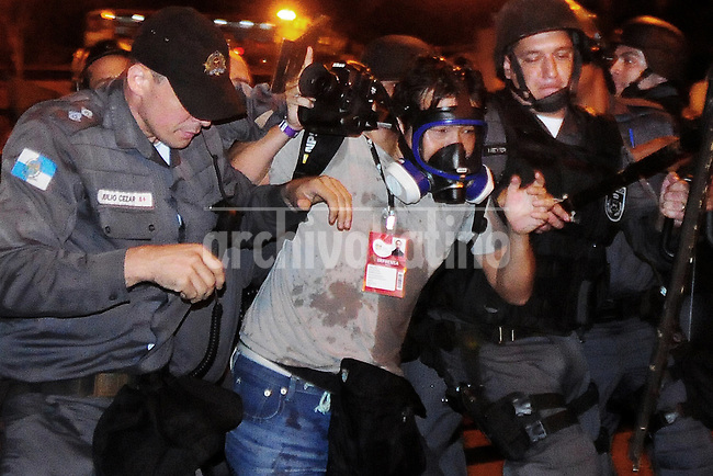 Japanese photographer Yasuyashi Chiba of Agence France Presse was injured by policemen in a protest during the Pope Francis visit,  Rio de Janeiro, Brazil, July 22, 2013.  The pontiff arrived for a seven-day visit in Brazil and to participate at church's World Youth Day festival meeting legions of young Roman Catholics. (Austral Foto/Sandro Voxx)