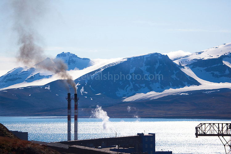 Coal fired power station pouring out smoke in Barentsburg. Barentsburg, a Russian coal mining town in the Arctic Norwegian Archipelego of Svalbard. Once home to about 2000 miners and their families, less than 500 people now live here.  The Arctic is one of the regions most obviously affected by cimate change, caused by the burning of fossil fuels like coal.
