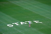 Buddy Gentry looks over the lettering at the center of Scott Field in Davis Wade Stadium prior to crews painting the &quot;M-State&quot; logo on the field. For 45 years, the Starkville resident has laid out the designs that are seen by tens of thousands of fans attending home MSU football games and the millions of fans who see the field on national television. His most recent work will be on display when MSU kicks off its season Saturday at 3 p.m. against Charleston Southern. <br />