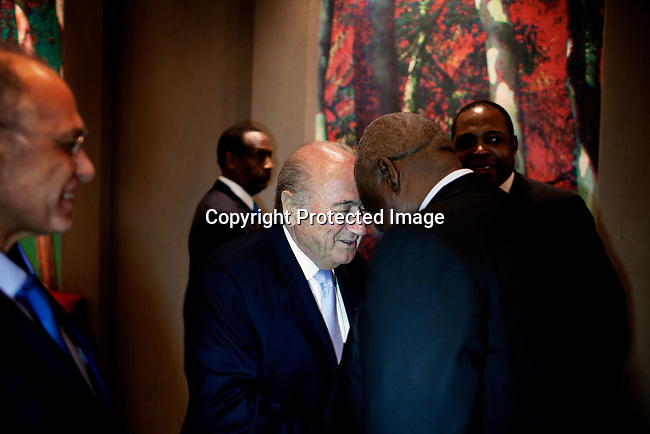 JOHANNESBURG, SOUTH AFRICA - FEBRUARY 9: FIFA president Sepp Blatter greets people before a dinner in his honor on February 9, 2013 at Sun international hotel in Sandton, Johannesburg, South Africa. Mr. Blatter visited South Africa to watch the final game of the CAP, Africa's Cup of Nations between Nigeria and Burkina Faso. (Photo by Per-Anders Pettersson)