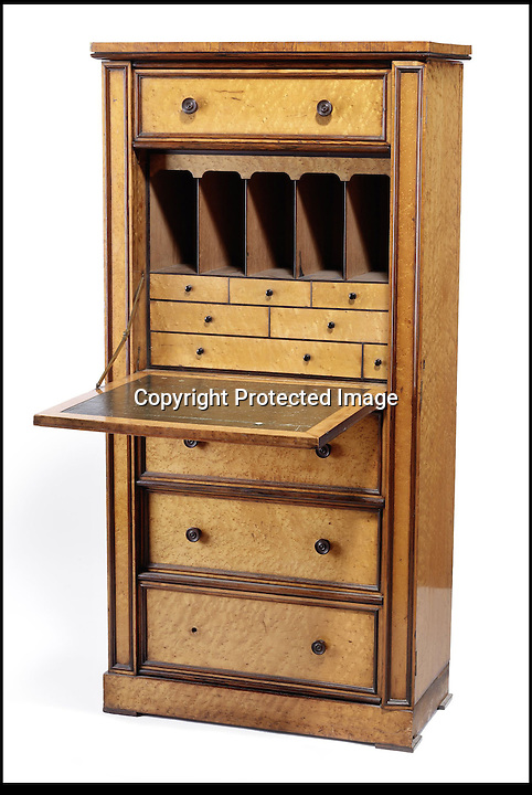 BNPS.co.uk (01202) 558833<br /> Picture: Bonhams<br /> <br /> A Victorian sectretaire Wellington chest, est £3,000<br /> <br /> It is the ultimate garden sale -- The aristocrat Cunliffe-Copeland family are auctioning off millions of pounds of antiques in a unique sale of the entire contents of their stately home Trelissick House near Truro in Cornwall. For generations the family have filled the magnificent The 18th century manor with treasures acquired from travels around the globe.<br /> <br /> 58 years ago the house was left to the National Trust on the condition members of the family could carry on living in the property. But the current incumbent, William Copeland and wife Jennifer, have decided to buy a normal-sized family home and are unable to take the hundreds of heirlooms with them. So they are holding a two-day sale of ancient ornaments, paintings, furniture, jewellery, silverware, books, rugs and wine in the grounds of Trelissick House, near Truro, later this month, and hope to raise £3million