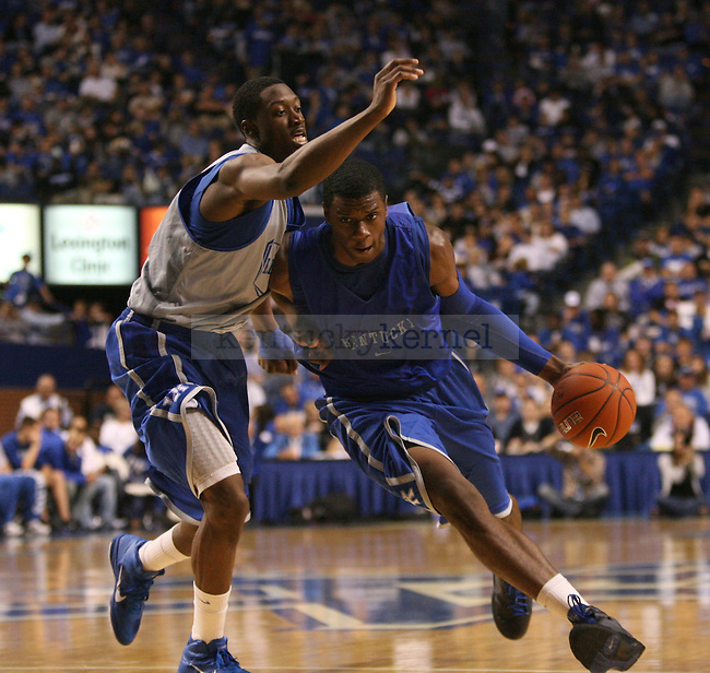 Freshman Terrence Jones dribbles into freshman Stacey Poole during the second half of the UK's mens basketball Blue White scrimmage held at Rupp Arena Tuesday, Oct. 26, 2010. Photo by Brandon Goodwin | Staff