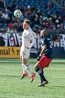 FOXBOROUGH, MA - MARCH 7: Djordje Mihailovic #14 of Chicago Fire heads the ball past Andrew Farrell #2 of New England Revolution during a game between Chicago Fire and New England Revolution at Gillette Stadium on March 7, 2020 in Foxborough, Massachusetts.