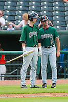 Trevor Brown (41) of the Augusta GreenJackets gets instructions from manager Mike Goff (9) during the South Atlantic League game against the Greensboro Grasshoppers at NewBridge Bank Park on August 11, 2013 in Greensboro, North Carolina.  The GreenJackets defeated the Grasshoppers 6-5 in game one of a double-header.  (Brian Westerholt/Four Seam Images)