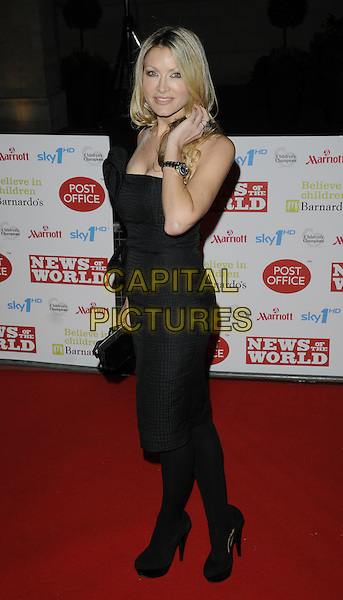 CAPRICE BOURRET .At the Children's Champions Awards 2010, Grosvenor House Hotel, Park Lane, London, England, UK, .March 3rd 2010..arrivals full length black strapless dress tights platform shoes clutch bag bow hand .CAP/CAN.©Can Nguyen/Capital Pictures.