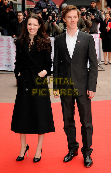 TALULAH RILEY & BENEDICT CUMBERBATCH.The Prince's Trust Celebrate Success Awards Odeon Cinema, Leicester Square, London, England..March 18th, 2008.full length black coat jacket grey gray suit hands in pockets.CAP/CAN.©Can Nguyen/Capital Pictures.